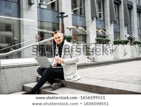 man sitting outside stock photo © photography33