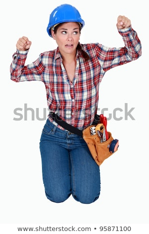 craftswoman kneeling and clenching her fists Stock photo © photography33