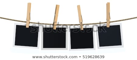 Stock photo: Pictures pinned on clothesline