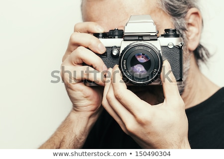 close up of photographer with photographic camera stock photo © wavebreak_media