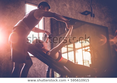 A personal trainer helping a man exercise Stock photo © IS2