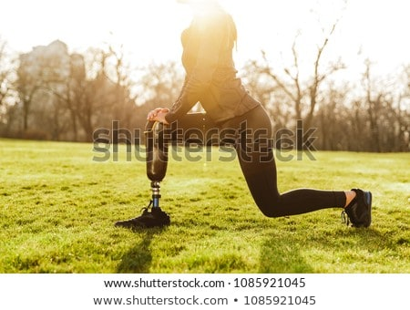 Cropped image of disabled athletic girl in black sportswear, doi Stock photo © deandrobot