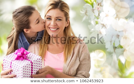 happy mother and daughter over cherry blossom Stock photo © dolgachov