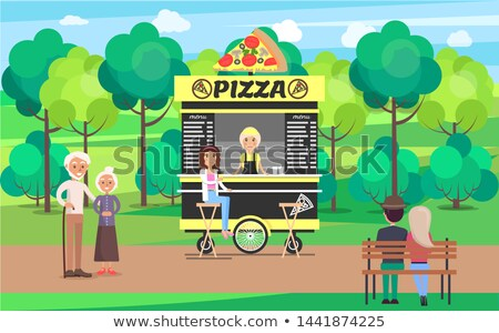 Delicious Pizza Street Cart with Vendor in Park Stock photo © robuart