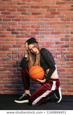 nő · kosárlabda · sportos · stúdiófelvétel · fekete · kéz - stock fotó © deandrobot