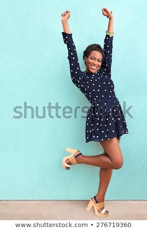 Sautant femme robe noire jeune femme visage santé Photo stock © Bananna