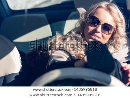 Young woman driver struggling to put on shoes Stock photo © Giulio_Fornasar