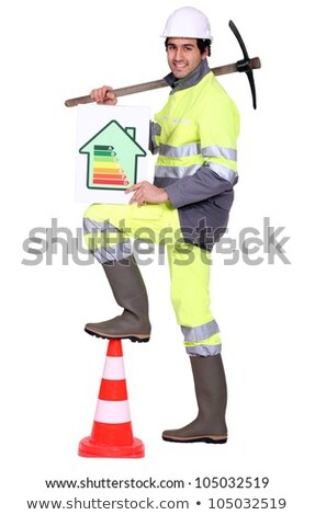 Construction worker holding a pickaxe and an energy efficiency rating sign Stock photo © photography33