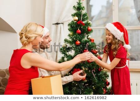 feliz · mulher · presentes · belo · branco · árvore · de · natal - foto stock © dolgachov