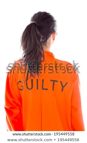 Rear view of a young Asian woman in prisoners uniform Stock photo © bmonteny