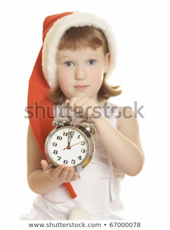 little girl wearing red santas hat with a big alarm clock stock photo © nobilior