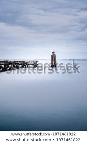 Image of a wooden dock near a marina. Stock photo © epstock