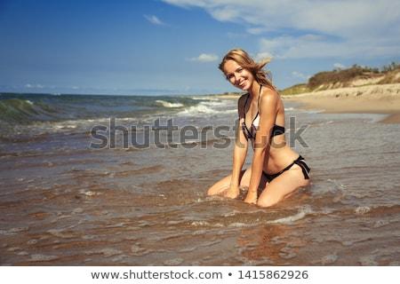 Happy pretty blonde bathing into the sea  Stock photo © wavebreak_media