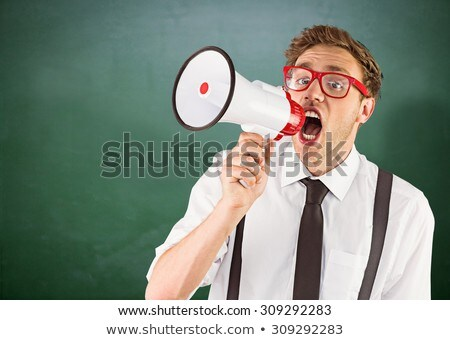 Geeky businessman shouting through megaphone Stock photo © wavebreak_media