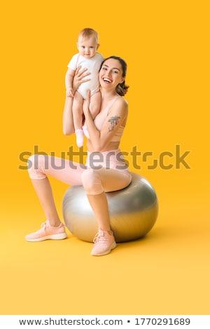 Foto stock: Pilates · mujer · pelota · ejercicio · entrenamiento · gimnasio