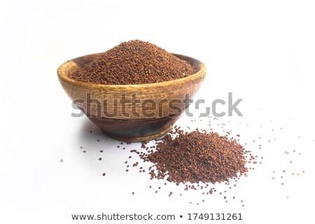 front view of bowl of organic brown mustard stock photo © ziprashantzi