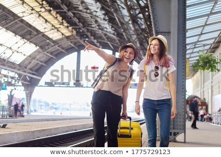 happy family on a rail station stock photo © konradbak