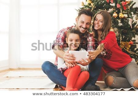 улыбаясь · молодые · семьи · красный · комнату · девушки - Сток-фото © Paha_L