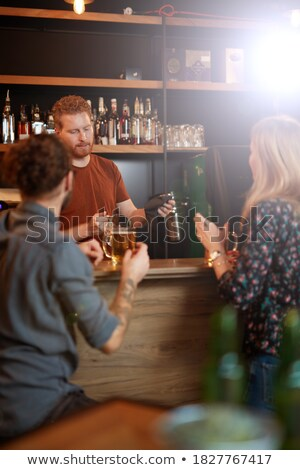 Couple having a glass of beer at counter Stock photo © wavebreak_media