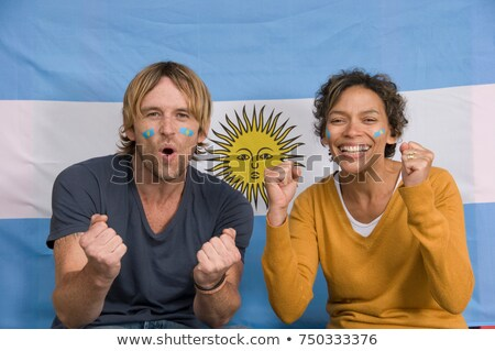 Couple smiling with Argentinian flag Stock photo © IS2
