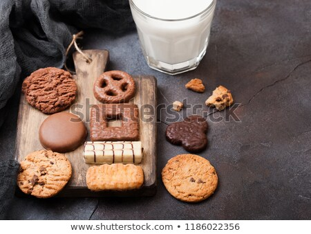 Oat and chocolate cookies selection on wooden board on stone kitchen table background. Space for tex stock photo © DenisMArt