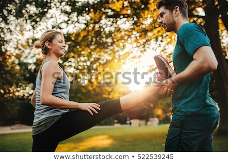 Young woman workout with her personal trainer in park Stock photo © boggy