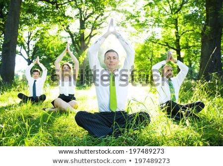 businesspeople doing yoga stock photo © andreypopov