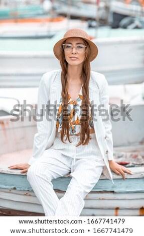 Młoda dziewczyna biały garnitur rufa przyjemność łodzi Zdjęcia stock © ElenaBatkova