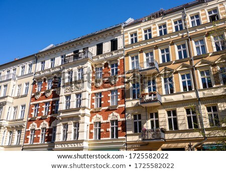 The fronts of some renovated old apartment buildings Stock photo © elxeneize