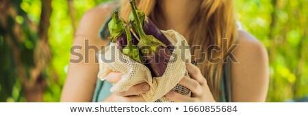 Avocado in a reusable bag in the hands of a young woman. Zero waste concept Stock photo © galitskaya