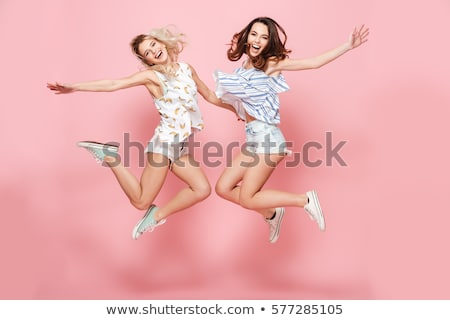 Blond woman jumping in the air Stock photo © RTimages