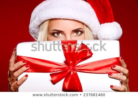 cheerful santa helper girl with gift box stock photo © dolgachov