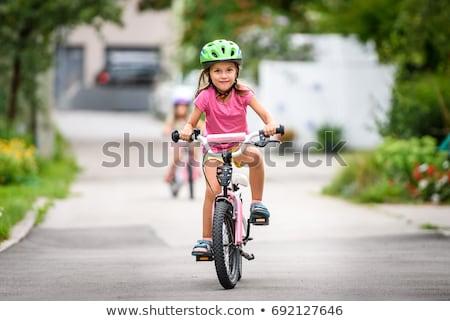 Stock fotó: Mosolyog · fiatal · lány · lovaglás · bicikli · park · teljes · alakos