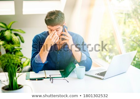 Thoughtful executive sitting with hand on forehead Stock photo © wavebreak_media