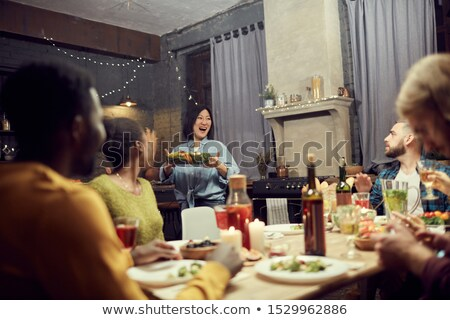 Woman bringing food to the lunch table Stock photo © IS2