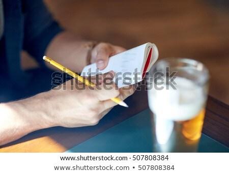 boldog · ír · jegyzettömb · bár · toll · éjszaka - stock fotó © dolgachov