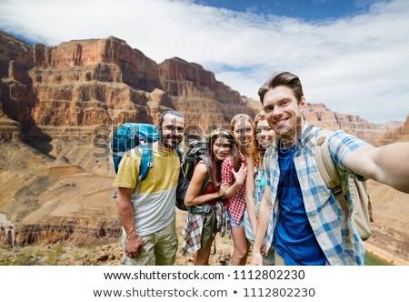 Mujer sonriente mochila Grand Canyon aventura viaje turismo Foto stock © dolgachov