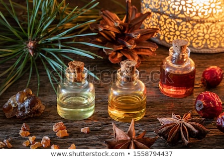 A bottle of myrrh essential oil with myrrh resin and a candle Stock photo © madeleine_steinbach
