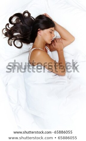 View from above of pretty brunette girl with long wavy hair and blue make up lying on pink floor, wi stock photo © studiolucky