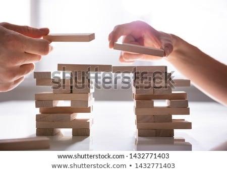 Human's Hand Placing Wooden Block Stock photo © AndreyPopov