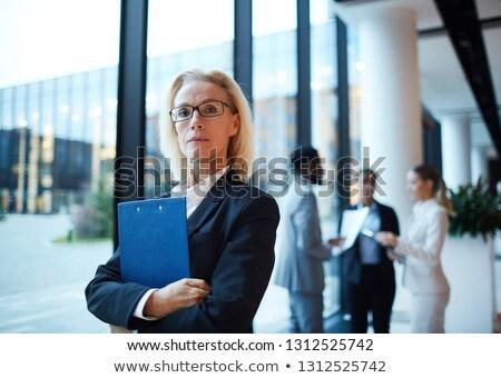 Confident mature female delegate in formalwear Stock photo © pressmaster