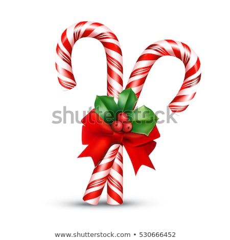 christmas candy cane with holly and ribbon stock photo © adrenalina