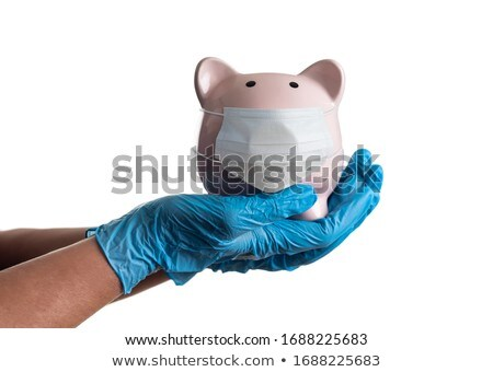 Doctor or Nurse Wearing Surgical Gloves Holding Piggy Bank Isola Stock photo © feverpitch