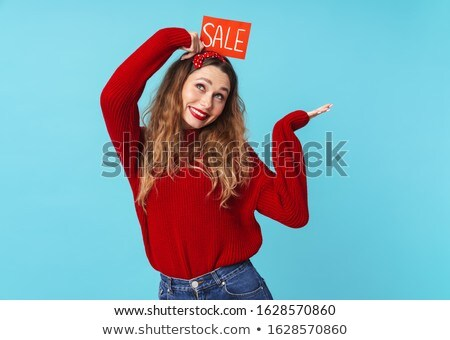 Image of amusing blonde woman holding placard and copyspace Stock photo © deandrobot