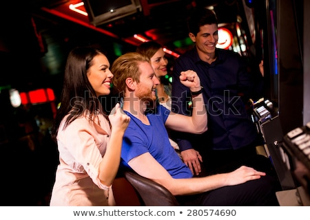 People Playing in Game Machines, Gambling Woman Stock photo © robuart