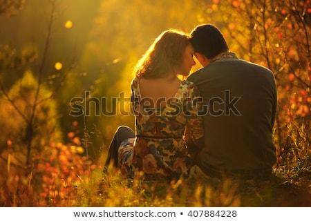 romantica · seduta · insieme · foresta · sorridere - foto d'archivio © HASLOO