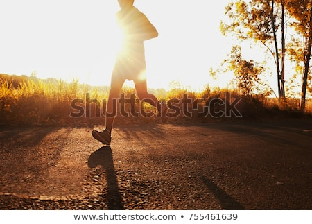 Sportsman is make exercise on hill stock photo © vetdoctor