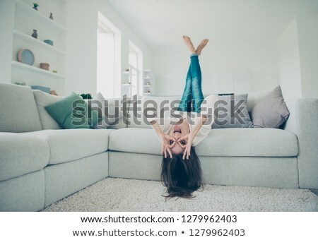 Brunette lady having amazing shapely legs Stock photo © konradbak