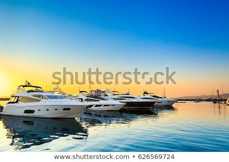 Marina görmek tekneler siluet yansıma gün batımı Stok fotoğraf © unikpix