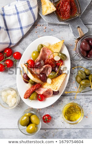 salami with baguette and green olives stock photo © zerbor